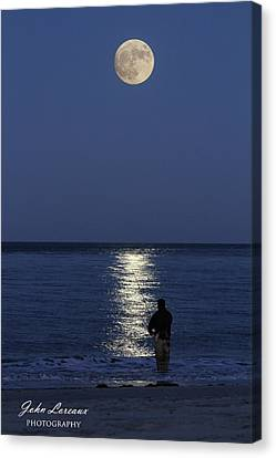 By The Light Of The Supermoon Canvas Print by John Loreaux