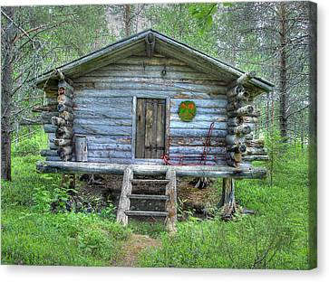Cabin In Lapland Forest Canvas Print by Merja Waters
