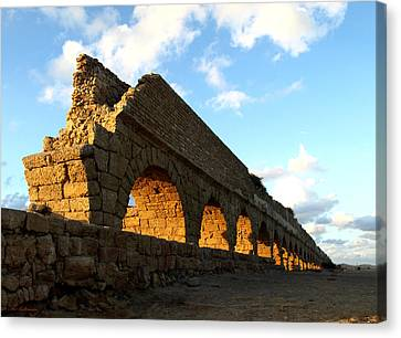 Caesarea  Aqueduct At Sunset. Canvas Print by Arik Baltinester