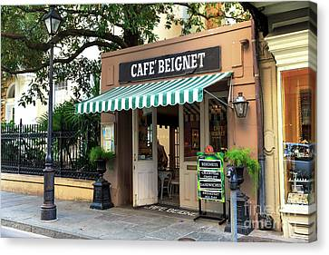 Cafe Beignet Canvas Print by John Rizzuto