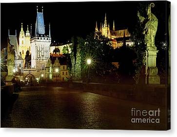 Charles Bridge And The Prague Castle Illuminated At Night Canvas Print
