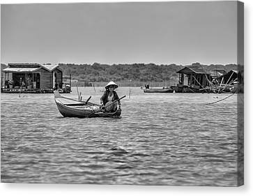 Cambodian Woman In A Boat Canvas Print by Georgia Fowler