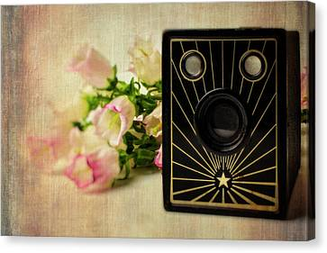 Camera And Campanula Flowers Canvas Print by Garry Gay