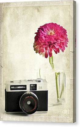 Camera And Flowers Canvas Print by Darren Fisher
