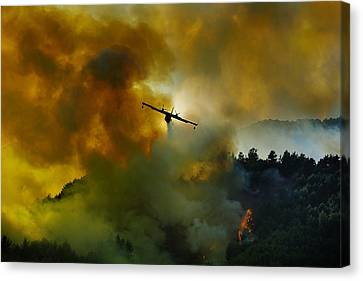 Canadair Aircraft In Action - Fighting For The Salvation Of The Forest. Canvas Print by Antonio Grambone