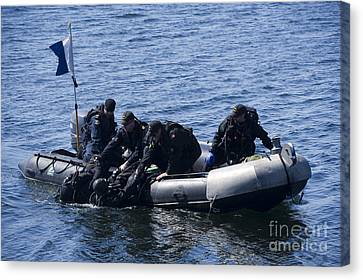 Canadian Divers Being Helped Aboard Canvas Print