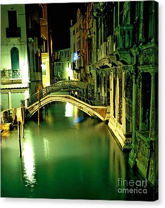 Canal And Bridge In Venice At Night Canvas Print by Michael Henderson