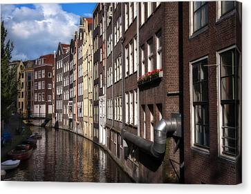 Canal Houses Canvas Print by Joan Carroll