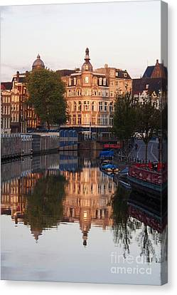 Reflecting Water Canvas Print - Canal Singel In Amsterdam. Netherlands. Europe by Bernard Jaubert