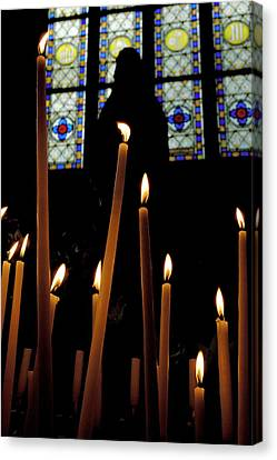 Candles Burning Inside The Basilica Of The Saint Sauveur Canvas Print by Sami Sarkis