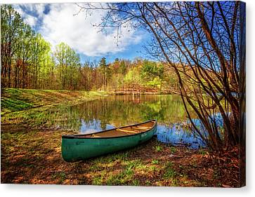 Canoe At Lakeside Canvas Print by Debra and Dave Vanderlaan
