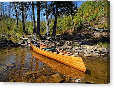 Canoe At Portage Landing Canvas Print by Larry Ricker