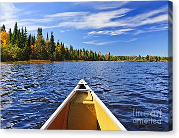 Canoe Bow On Lake Canvas Print by Elena Elisseeva