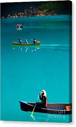 Canoeing On Glaciel Waters Canvas Print