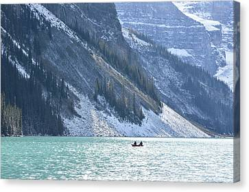 Canoeing On Lake Louise Canvas Print by Keith Boone