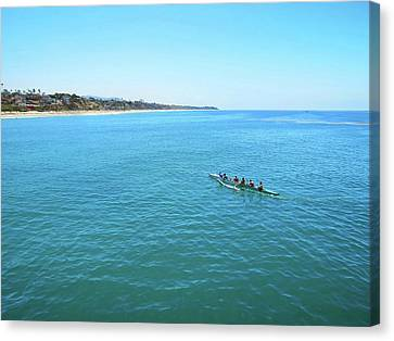 Canoeing On The Pacific Canvas Print by Connor Beekman