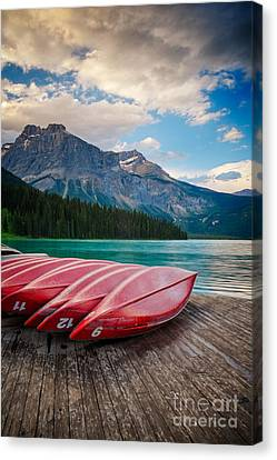 Canoes At Emerald Lake In Yoho National Park Canvas Print