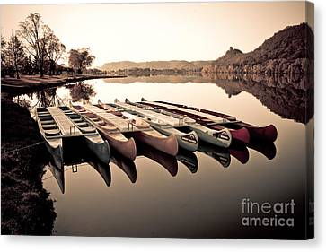 Canoes In The Early Morning Canvas Print by Kari Yearous