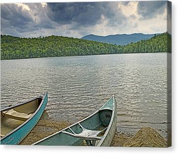 Canoes On Heart Lake Adirondack Park New York Canvas Print by Brendan Reals
