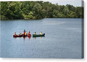 Canoes On Lake Canvas Print by Blink Images