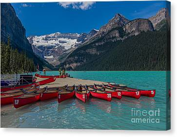 Canoes On Lake Louise Canvas Print