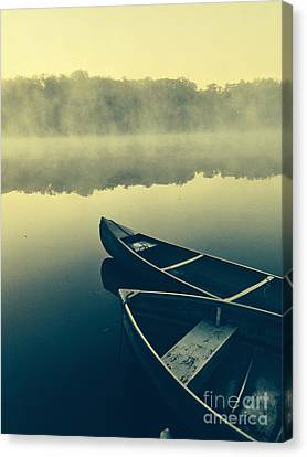 Canoes On Lake Canvas Print by Edward Fielding