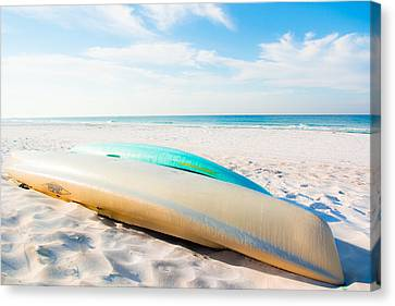 Canoes On The Beach In Seaside Florida Canvas Print by Shelby Young