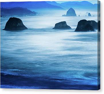 Canon Beach Blues Canvas Print by Debi Bishop