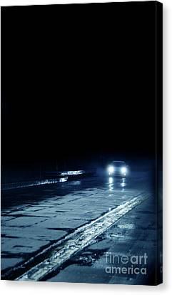 Car On A Rainy Highway At Night Canvas Print by Jill Battaglia