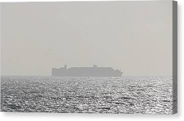 Canvas Print featuring the photograph Cargo Au Large by Marc Philippe Joly