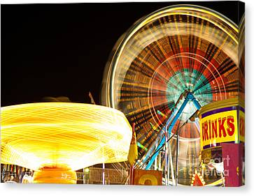 Carnival Rides At Night Picture Canvas Print by Paul Velgos