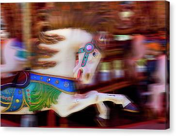 Carousel Horse In Motion Canvas Print by Garry Gay