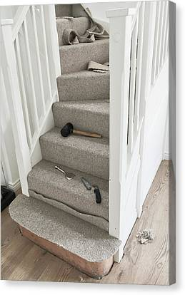 Carpet Fitting Canvas Print by Tom Gowanlock