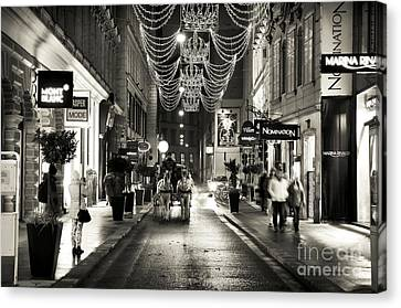Carriage Ride Down The Street Canvas Print by John Rizzuto