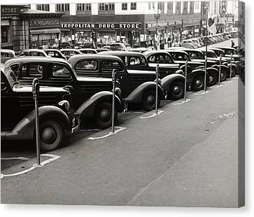 Cars Parked Diagonally Along Parking Canvas Print by Everett