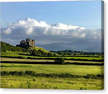 Cashel Castle On The Rock Of Cashel Canvas Print by Chris Hill