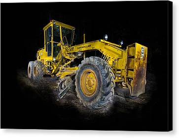 Caterpillar Grader Canvas Print by Paul Freidlund