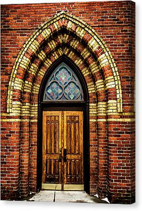 Cathedral Tower Door Canvas Print by Onyonet  Photo Studios