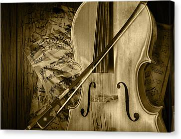 Cello Stringed Instrument With Sheet Music And Bow In Sepia Canvas Print by Randall Nyhof