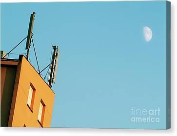 Cellular Phone Antennas And A Half Moon At Sunset Canvas Print by Sami Sarkis