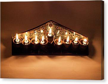 Ceramic Chanukkiah Lit With Eight Lights And One Lighter, The Shamash, Viewed From The Top Canvas Print by Yoel Koskas