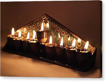 Ceramic Chanukkiah Lit With Eight Lights And One Lighter, The Shamash, Viewed On The Side Canvas Print by Yoel Koskas