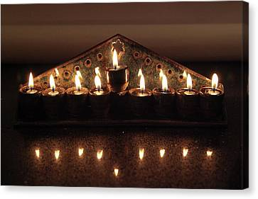 Ceramic Chanukkiah Lit With Eight Lights And One Lighter, The Shamash Canvas Print by Yoel Koskas