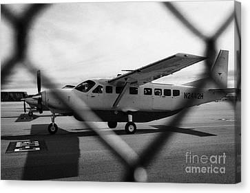 cessna 208B sightseeing tour aircraft at Grand canyon west airport Arizona USA Canvas Print by Joe Fox