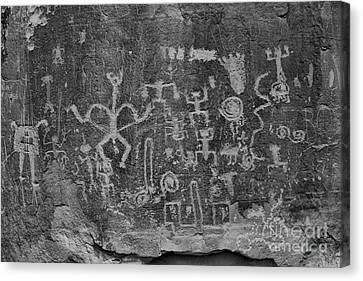 Canvas Print featuring the photograph Chaco Canyon Petroglyphs Black And White by Adam Jewell