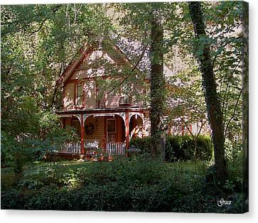 Chalet In The Trees Canvas Print by Julie Grace