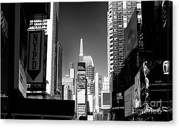 Challenges In Times Square Canvas Print by John Rizzuto