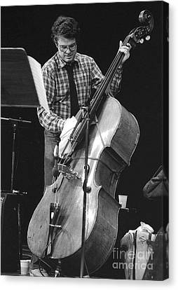 Charlie Haden Takes Care Of His Doublebass Canvas Print by Philippe Taka