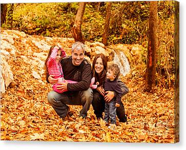 Cheerful Family In Autumn Woods Canvas Print