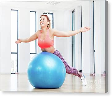 Fitness Instructor Canvas Print - Cheerful Woman Training With Fitball At Fitness Club. by Michal Bednarek